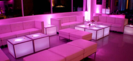 ... Showcasing The White Lounge Furniture Rental Options With Pink And Red  Lighting.