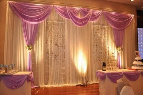 A great example of a white pipe and drape rental with pink/purple highlights.